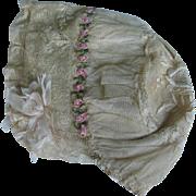 Antique bonnet lace and silk.