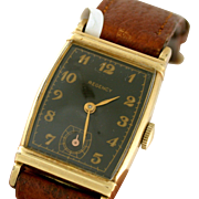 Regency 10k rolled gold watch with charcoal face and gold hardware and numbers circa 1979 with brown leather band. Unisex design.