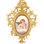 Excellent Hand Painted Porcelain Plaque of a Cherub framed in a Sweet Gold Gilt Frame, 19th Century