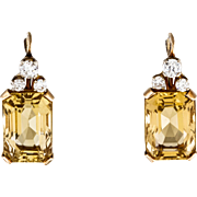 Beautiful 14K yellow and white gold drop earrings featuring 22.82 carats of rectangular emerald cut citrines.