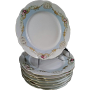 Beautiful set of Eight Antique Hand Painted Porcelain Salad or Dessert Plates with Pale Blue and Floral Gilt Pattern