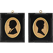 Two Miniature Portraits of Man and Woman in Black Lacquered Frames, dated 1929