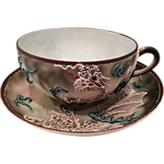 Japanese Moriage Dragonware Nippon Cup on a Takito Saucer