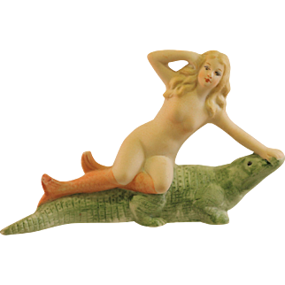 Bisque Bathing Beauty Mermaid Doll atop an Alligator