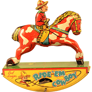 Vintage Lithographed wind up Red Ranger Rid'EM Cowboy Toy by Wynandotte