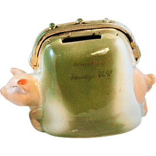 Vintage Pig in a Purse Figural Still Bank made in Germany