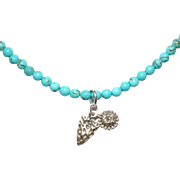 Turquoise Necklace with Sterling Silver Arrow and Sunface Charms.