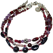 Sterling Silver, Garnet, Amethyst, and Blue Goldstone 3 Strand Bracelet.