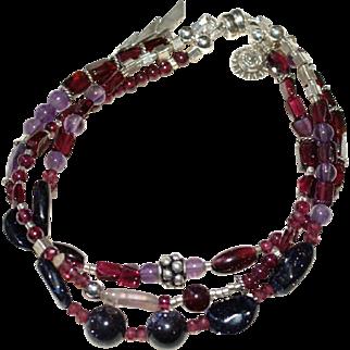 Sterling Silver, Garnet, Amethyst, and Blue Goldstone 3 Strand Bracelet.