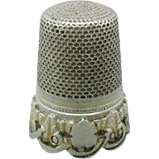 A French silver thimble with applied border. c 1870