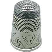 A steel topped English silver thimble. Early 19th century.