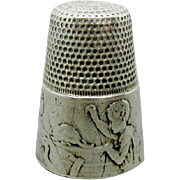 'The Sewing Family' A Gabler silver thimble. German. c 1900