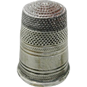 A Russian silver thimble with a steel cap. 1880-1890.