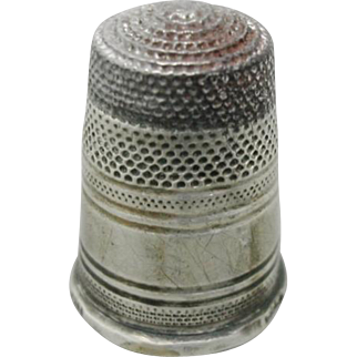 A Russian steel topped silver thimble.