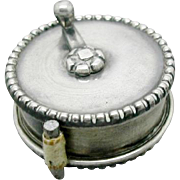 A small sterling silver tape measure. 19th century