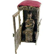 A novelty pin cushion-sedan chair. 19th century.