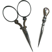 Engraved and gilded steel scissors and matching stiletto. French c 1860
