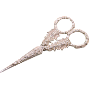 A pair of silver handled scissors and sheath. English Regency period c 1830