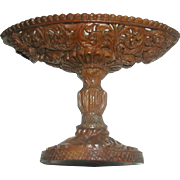 A quality carved and pierced corozo nut pin dish. c 1830
