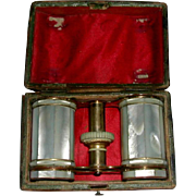 A pair of cased opera glasses.