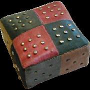 A miniature silk patchwork pin cushion. c 1830