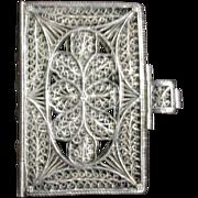 A Georgian silver filigree miniature book cover. c 1800