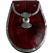Sale Pending-        A Georgian red leather purse with silver trim. c 1800