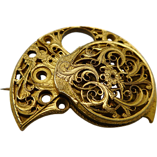 A Victorian watch cock brooch. c 1890