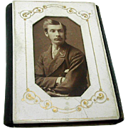 A 19thc pocket book incorporating a photograph.