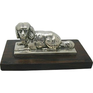 An adorable 19th century silver dog paperweight.