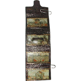 A leather needle packet case with needle prints. c 1860