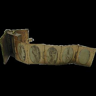 A mini brass photo 'keepsake locket'.