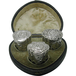 An unusual boxed group of three Dutch silver peppermint boxes.