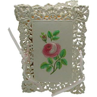 A pierced card needle book. c 1860