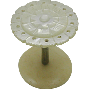 A mother of pearl topped cotton reel / spool. 19thc