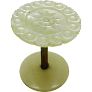 A small pearl topped spool from a Victorian sewing box.