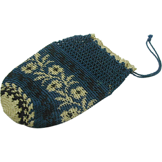 A small navy blue and fawn knitted purse. 19thc