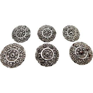 A set of six riveted, cut steel buttons. Early 19th century.