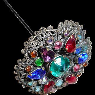 A jewelled filigree hatpin. Edwardian. c 1900