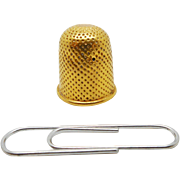 An 18th century gold thimble for a child.