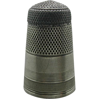A tall Georgian silver thimble with a steel cap. Early 19th century c 1800