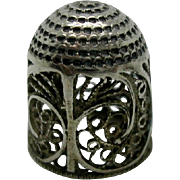 Child's 18th century silver filigree thimble.