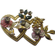 Vintage two heart jeweled brooch.
