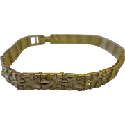 Fabulous 10k yellow gold textured bracelet ( Michael Anthony )