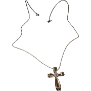 Beautiful 10k yellow gold cross necklace, with diamonds