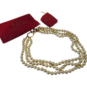 Collectable KJL three strand simulated pearl necklace