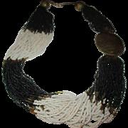 Vintage 37 glass beaded strand brass necklace