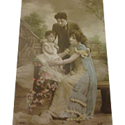 Beautiful hand tinted photo of family Art Noveau