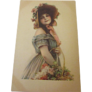 Art Noveau post card lady with basket of flowers