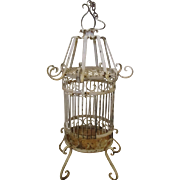 Early 1900's cast iron bird cage, original white paint.